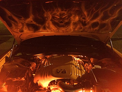 Custom flames and skulls on hood liner of Dodge Charger LED lighting
